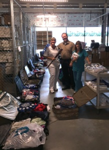Wendy, Linda and Todd packing extra 20 suitcases to bring with donations. Not seen in picture was team member Charlie Peters.
