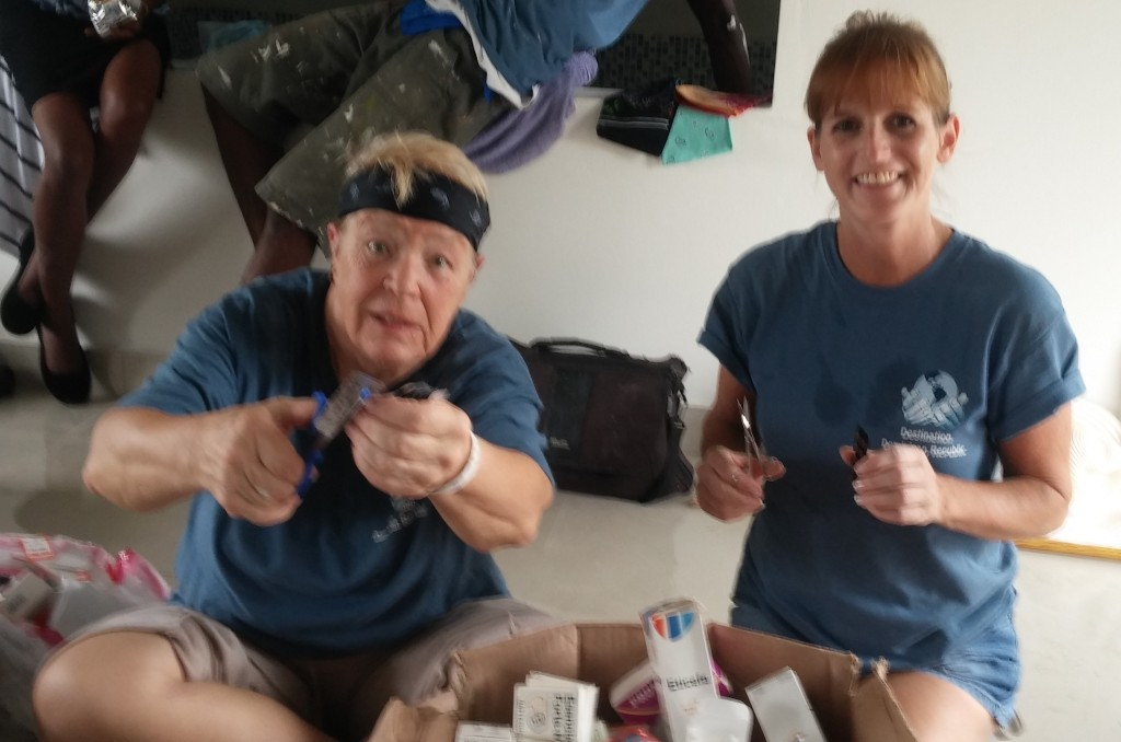 Pat and Wendy taking time to assist the medical crew with the pharmacy and preparing meds.