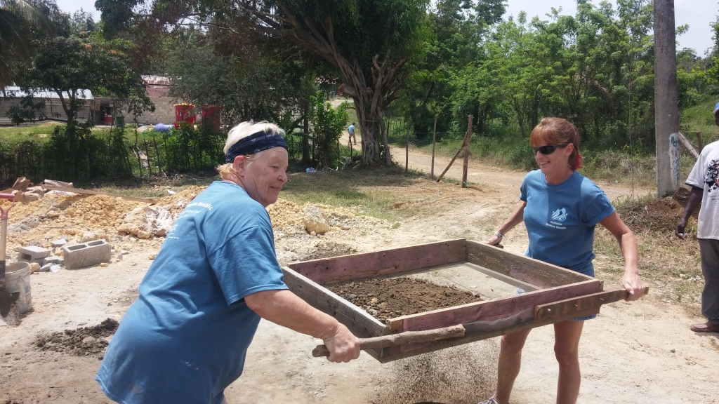 Pat and Wendy sifting dirt for the cement sidewalk.