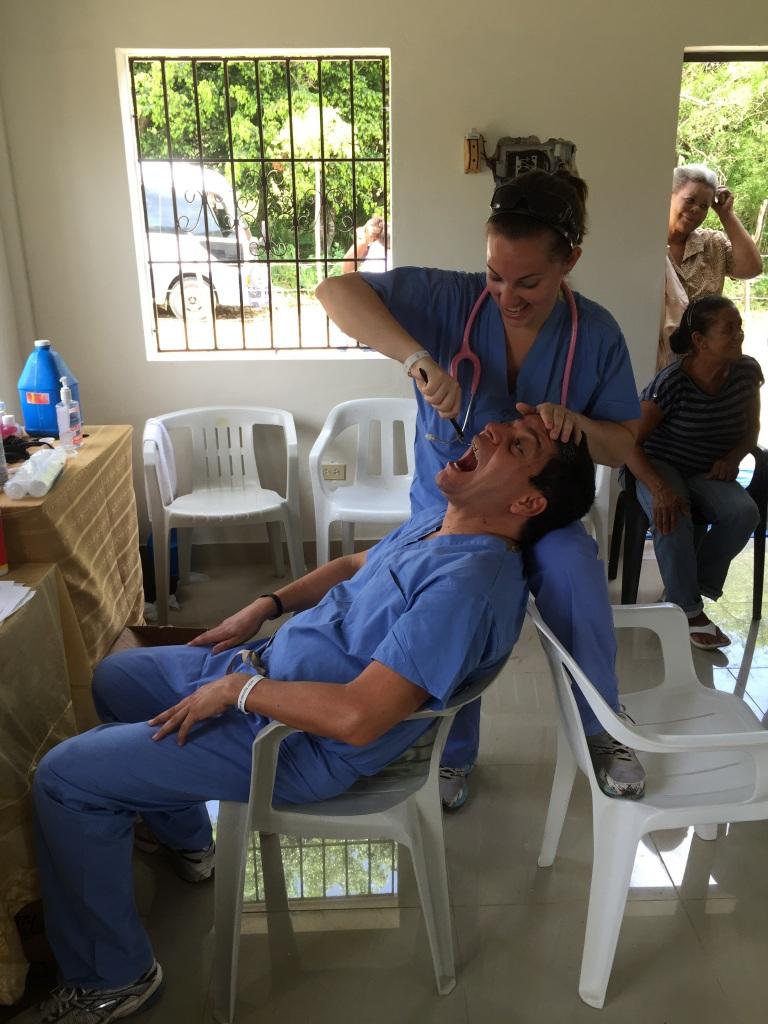 Danielle trying dentistry on Dr. Santin.  :)