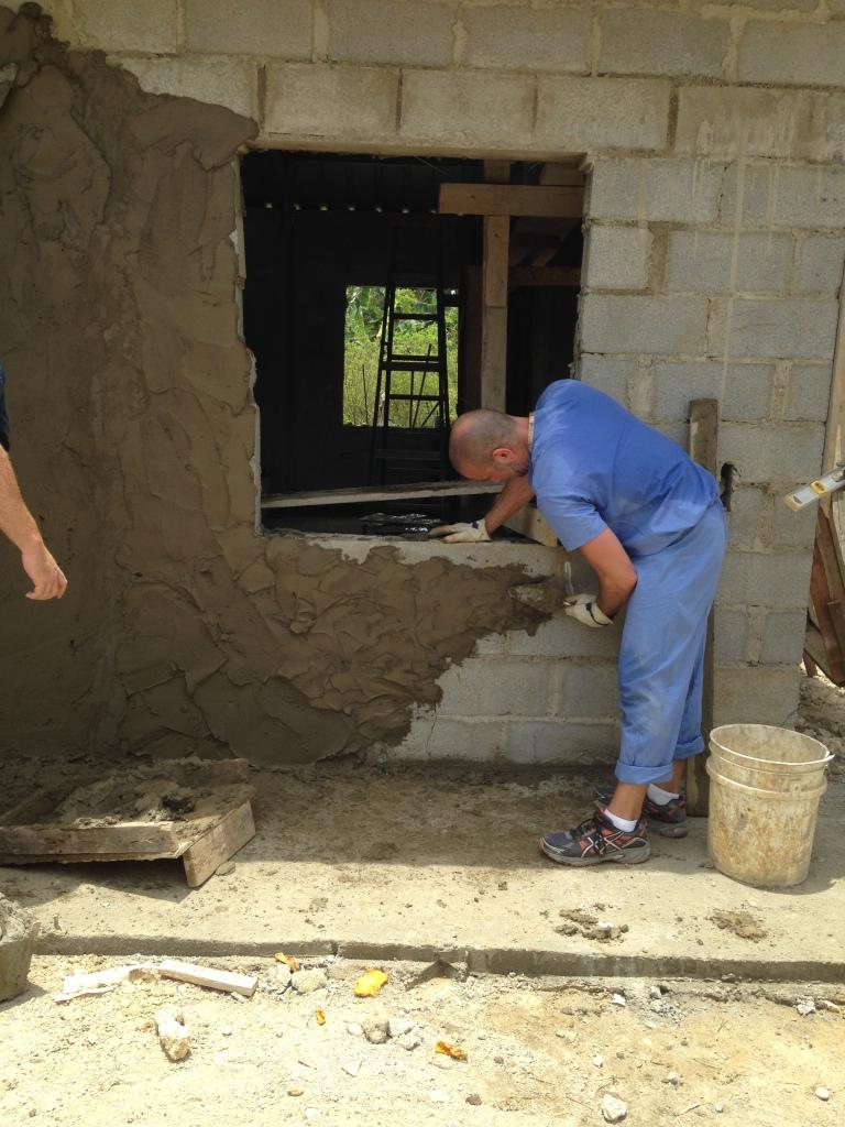 Matt adding mortar to the concrete block.