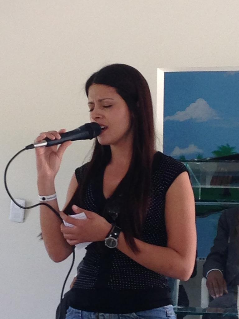 Priscilla singing at church