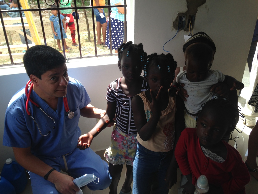 Dr. Santin overseeing the burned child.
